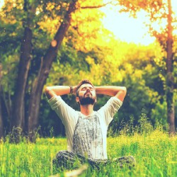 man-meditation-arms-wide-nature-quiet-field-trees-breath
